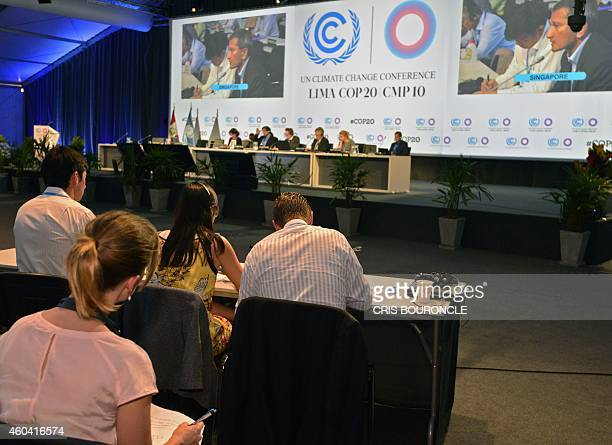 Members of representative commissions of the countries participating in the climate change conferences attend the seventh plenary meeting of the...