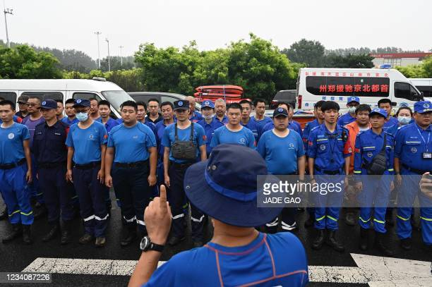 Members of rescue organization Bluesky rescue team assemble before heading to Zhengzhou, a flood-hit city in central China, in Beijing on July 21,...
