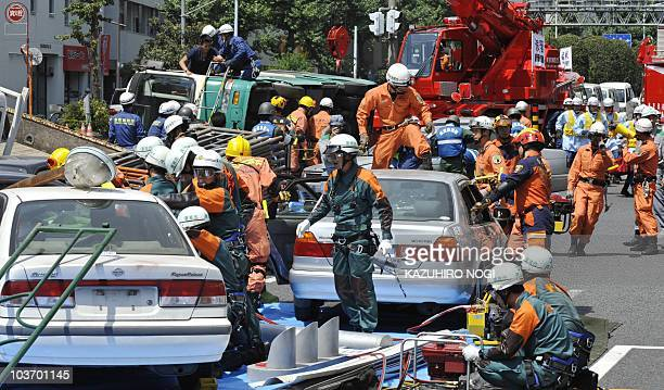 Members of rescue teams from the Fire and Disaster Management Agency the SelfDefense Forces and the Metropolitan Police Department take part in a...