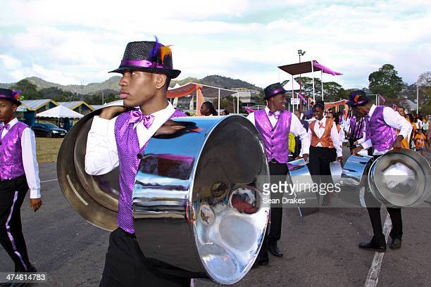 Members of Revelation Institute for Performing Education Steel Orchestra move their instruments onto the stage at Junior Panorama in Port of Spain...