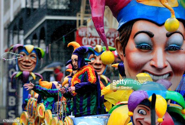 Members of Rex parade down St Charles Avenue despite the rain Mardi Gras Day on March 4 2014 in New Orleans Louisiana Fat Tuesday the traditional...