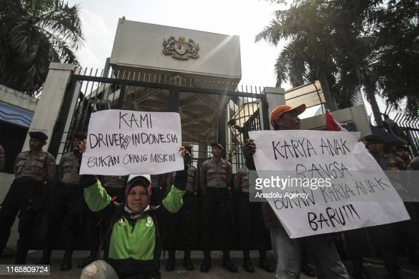 Members of ridehailing services stage a demonstration against the founder and owner of Big Blue taxi services in Malaysia Datuk Shamsubahrin Ismail...