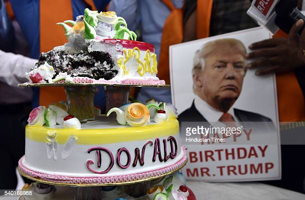 Members of rightwing Hindu group Hindu Sena cutting cake to celebrate the birthday of Republican presidential candidate Donald Trump on June 14 2016...