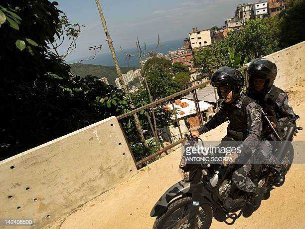 Members of Rio de Janeiro' Special Forces patrol Rocinha shantytown on motorbike on April 4 2012 hours after a police officer was killed here Nine...