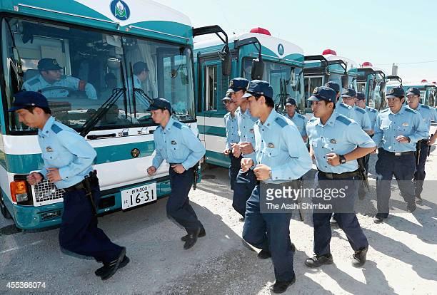 Members of riot police from Gunma Nagasaki Yamaguchi and Saga prefectures line up during a ceremony on September 13 2014 in Kitakyushu Fukuoka Japan...