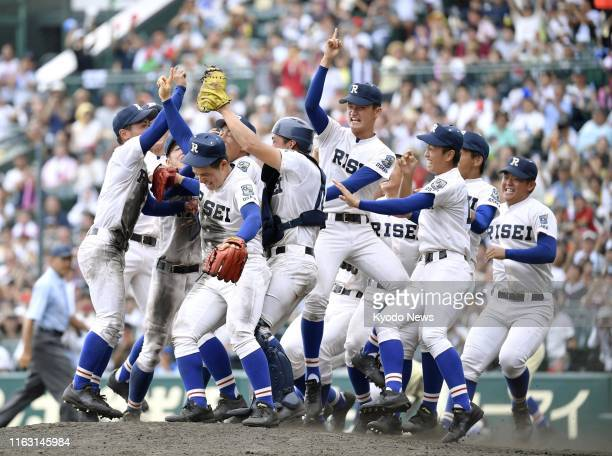 Members of Riseisha High School celebrate after beating Seiryo High School 5-3 in the final of the 101st national high school baseball championship...