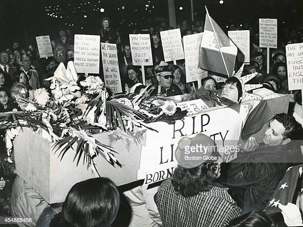 """Members of ROAR stage the death of """"Miss Liberty"""" at the site of the Boston Massacre near the Old State House in Boston on March 5, 1975. An..."""