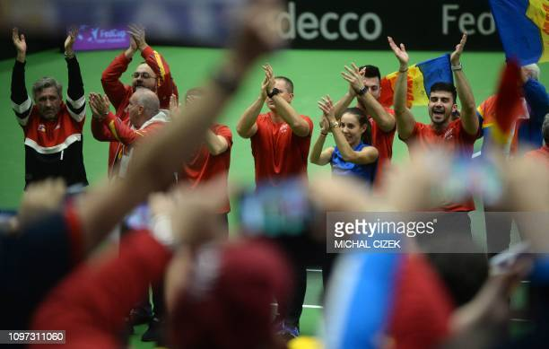 Members of Romanian Fed Cup team celebrate after they defeated the Czech Republic in Fed Cup tennis match between Czech Republic and Romania on...