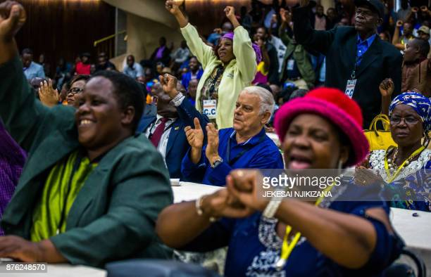 Members of ruling ZANUPF party react upon the annoucement of the party's president dismissal on November 19 2017 in Harare Zimbabwe's ruling party...