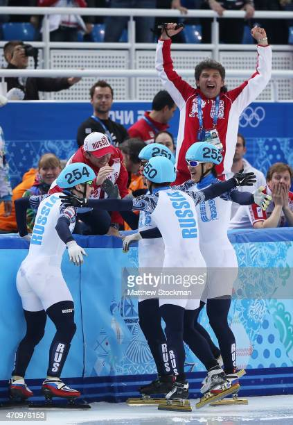 Members of Russia Short Track team celebrate winning the gold medal in the Short Track Men's 5000m Relay on day fourteen of the 2014 Sochi Winter...