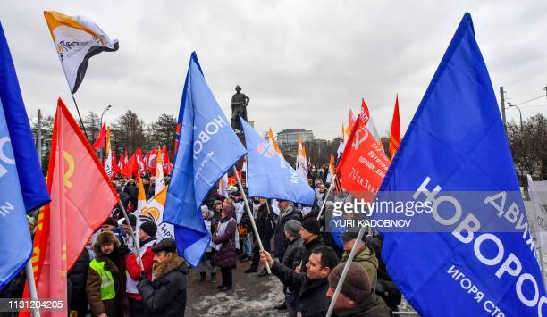 Members of Russian opposition parties and movements attend an opposition rally For Russia Justice New Deal in central Moscow on March 17 2019...
