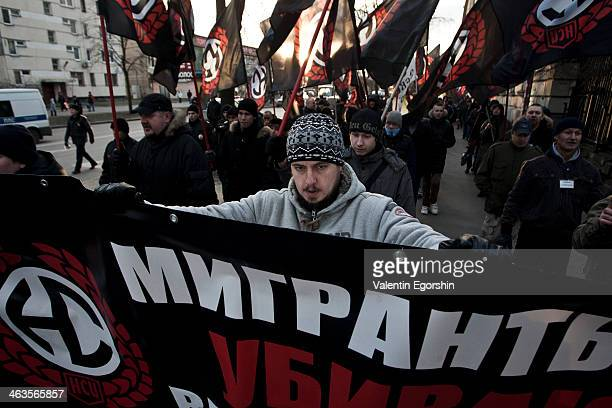 CONTENT] Members of Russian Radical Nationalistic movement shout slogans during a rally against ethnic crime and ethnic violence