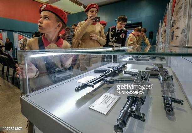 """Members of Russia's Yunarmiya youth patriotic movement attend the opening of the exhibition entitled """"Kalashnikov, a soldier, a designer, a legend""""..."""