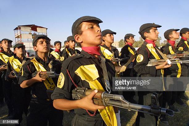 Members of Saddam's cubs an Iraqi military youth group train during a summer camp program in Baghdad 11 August 2002 Warmongering by US President...