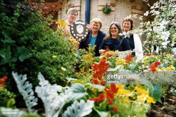 Members of Saltburn Residents and Britain in Bloom Committees with the new Lens Sanders Memorial Trophy LR Keith Muir Jackie Taylor Eileen Robinson...