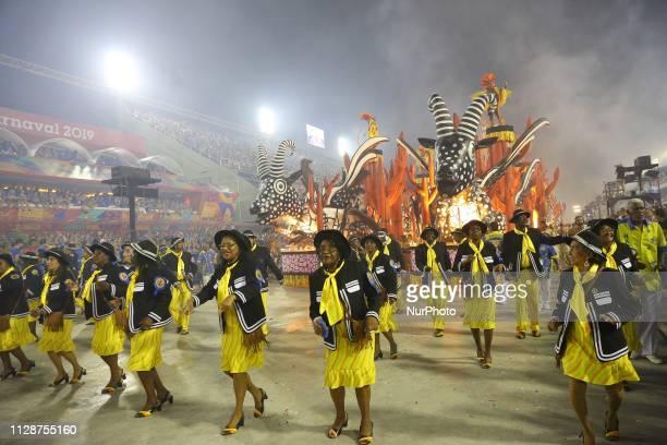 Members of Samba School Paraiso of Tuiuti perform during the parade at 2019 Brazilian Carnival at Sapucai Sambadrome on March 04 2019 in Rio de...