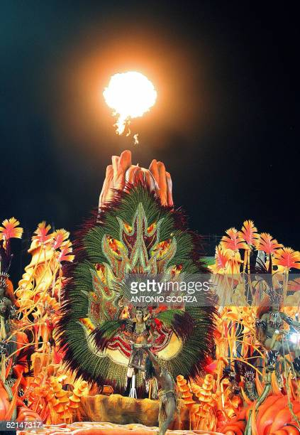 Members of samba school Salgueiro dance atop a float 06 February in Rio de Janeiro's Sambodrome during the opening of the traditional parade The...