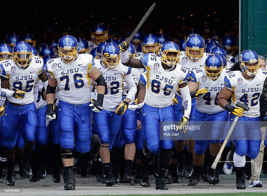 Members of San Jose State Spartans take the field before the start of the Military Bowl against the Bowling Green Falcons at RFK Stadium on December 27, 2012 in Washington, DC.