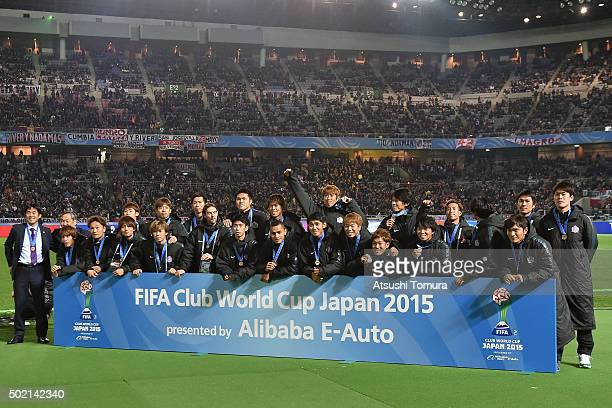 Members of Sanfrecce Hiroshima celebrate after winning the FIFA Club World Cup 3rd place match between Sanfrecce Hiroshima and Guangzhou Evergrande...