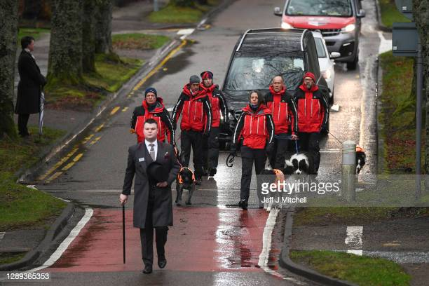 Members of SARD form a guard of honour with their dogs, for the Funeral cortege of Dr Hamish MacInnes OBE BEM, mountaineer as it makes its way...