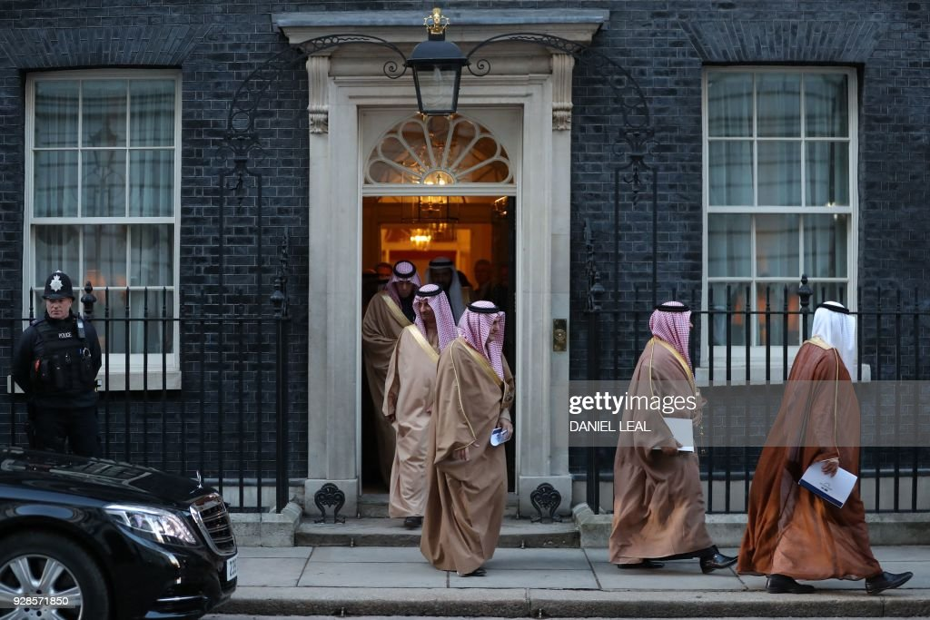 TOPSHOT - Members of Saudi Arabia's Crown Prince Mohammed bin Salman's delegation leave 10 Downing Street, in central London on March 7, 2018. British Prime Minister Theresa May will 'raise deep concerns at the humanitarian situation' in war-torn Yemen with Saudi Crown Prince Mohammed bin Salman during his visit to Britain beginning Wednesday, according to her spokesman. /