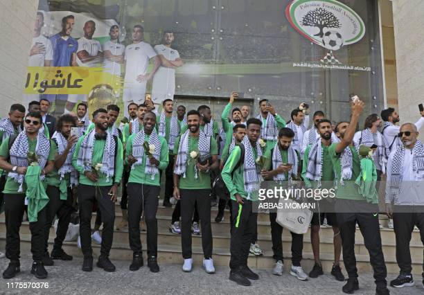Members of Saudi Arabia's national football team are welcomed in the Palestinian city of Ramallah on October 13 2019 upon the team's arrival in the...