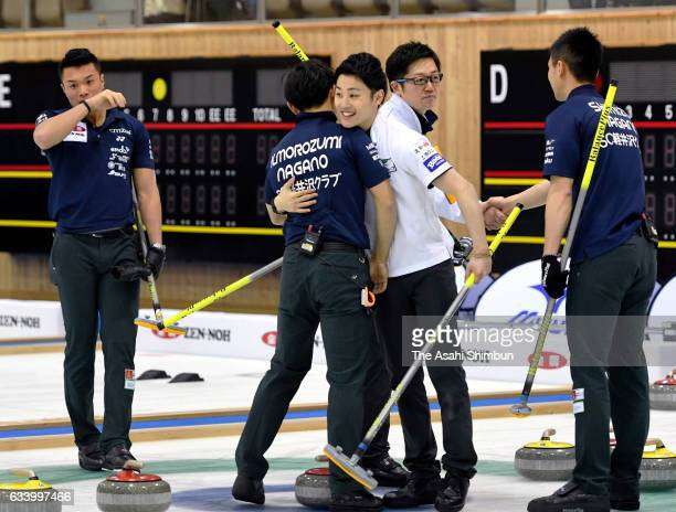 Members of SC Karuizawa are congratulated by Members of Sapporo after winning the Men's final during day seven of the 34th All Japan Curling...