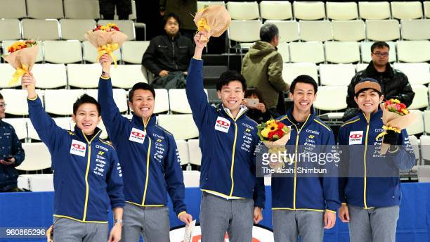 Members of SC Karuizawa celebrate after beating Team IWAI on day three of the 2018 PacificAsia Curling Championships Trial at Advics Tokoro Curling...