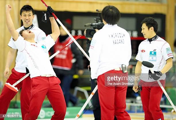 Members of SC Karuizawa celebrate winning the 31st All Japan Curling Championships at Karuizawa Ice Park on March 9 2014 in Karuizawa Nagano Japan