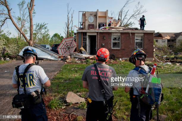 members of search and rescue inspect homes in Trotwood Ohio on May 28 after powerful tornadoes ripped through the US state overnight causing at least...