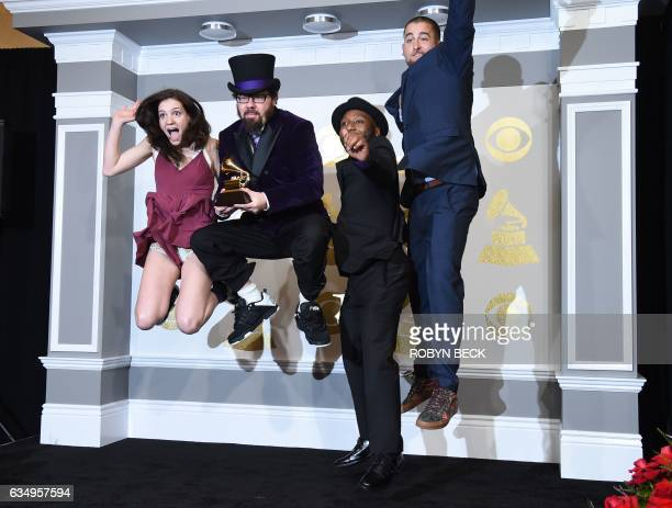 Members of Secret Agent 23 Skidoo pose in the press room with the Best Children's Album Grammy for Infinity Plus One during the 59th Annual Grammy...