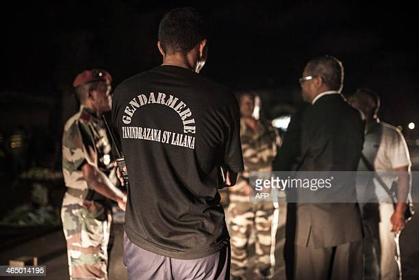Members of security forces stand at the site of a grenade explosion in Antananarivo's Anosy district on January 25 just hours after the island's...