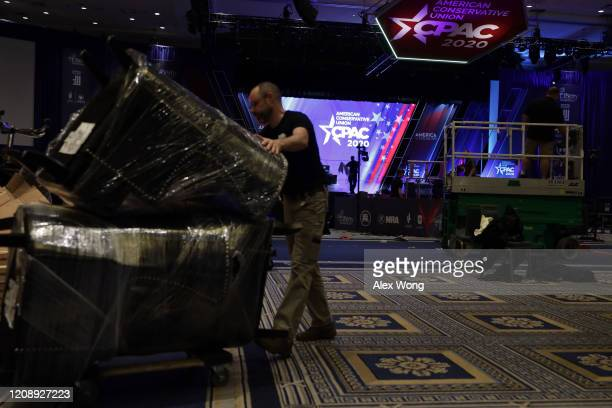 Members of set up crew work on the final setup during the annual Conservative Political Action Conference at Gaylord National Resort Convention...