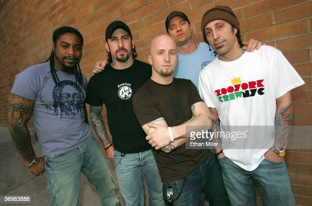 Members of Sevendust singer Lajon Witherspoon guitarist John Connolly bassist Vince Hornsby guitarist Sonny Mayo and drummer Morgan Rose pose...