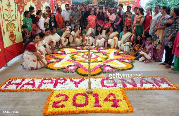 Members of Shyam Nagar Annex Malayalees' Association make AthaPookalam a rangoli made by using flowers of several colours during the Onam...