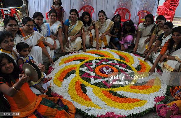 Members of Shyam Nagar Annexe Malayalees Association make AthaPookalam a rangoli made by using flowers of several colours to welcome Bhagwan Mahabali...