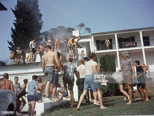 Members of Sigma Pi and Phi Kappa Sigma fraternities have a waterfight on the UCLA campus Los Angeles California April 3 1957