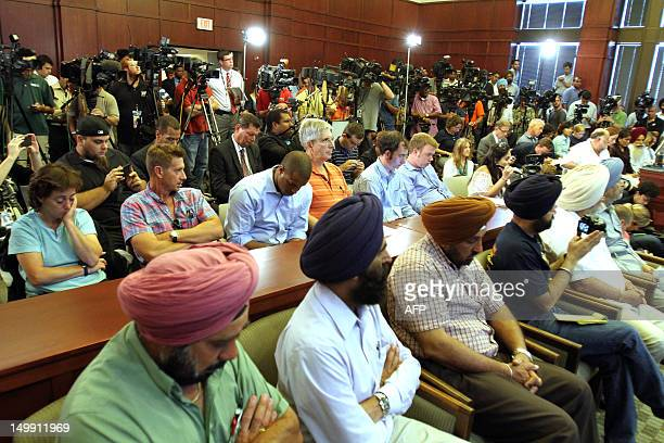Members of Sikh community attend the press conference August 6 2012 in Oak Creek Wisconsin about the shootings Sunday at the Sikh Temple of Wisconsin...