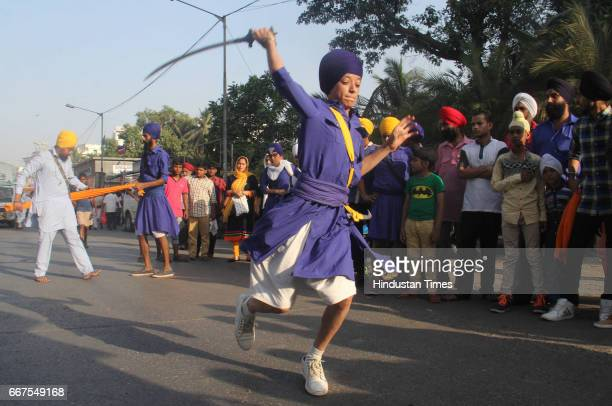 Members of Sikh community perform Gatka martial arts during the procession on occasion of Baisakhi at Marol Andheri on April 9 2017 in Mumbai India...