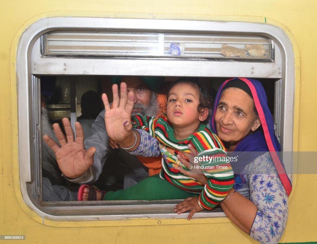 Members of Sikh Jatha leaving for Pakistan to celebrate birth anniversary of Guru Nanak Dev Ji from Attari railway station on November 2 2017 near...