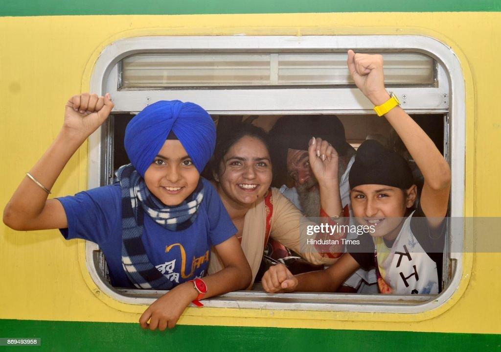 Members of Sikh Jatha waiting for train which will leave for Pakistan to celebrate birth anniversary of Guru Nanak Dev Ji from Attari railway station.