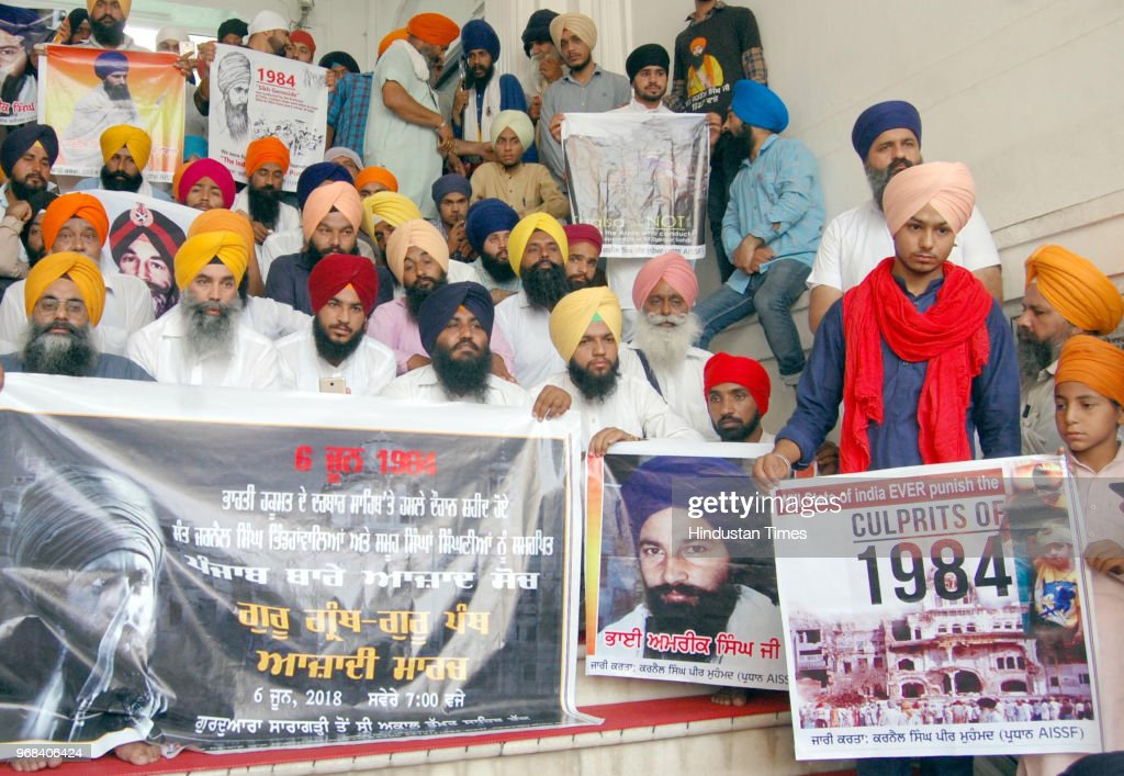 Members of Sikh Students Federation Mehta displaying posters of militant Jarnail Singh Bhindranwale and former Sikh Students Federation leader Amrik..