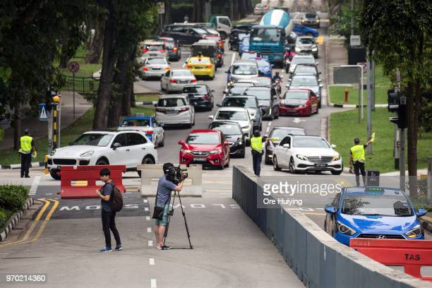 Members of Singapore Police Force direct traffic at road closures next to St Regis Hotel on June 9 2018 in Singapore The historic meeting between US...