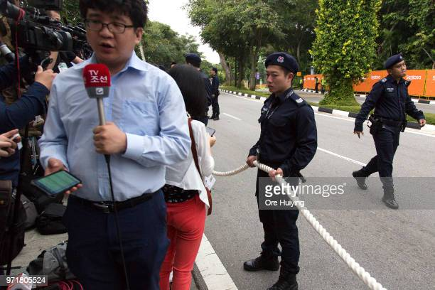 Members of Singapore Police Force stand guard outside Capella Hotel in Sentosa on June 12 2018 in Singapore US President Trump and North Korean...