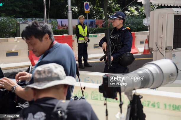 Members of Singapore Police Force stand guard outside St Regis Hotel on June 11 2018 in Singapore The historic meeting between US President Donald...