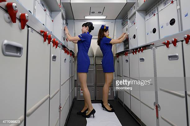 Members of Skymark Airlines Inc's cabin crew pose for a photograph inside the company's Airbus A330 aircraft during a media preview at Haneda Airport...
