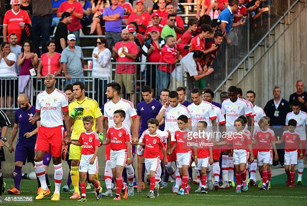 Members of SL Benfica and ACF Fiorentina walk onto the field before an International Champions Cup 2015 match at Rentschler Field on July 24 2015 in...