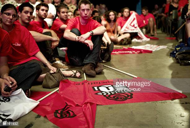 Members of Socialist party listen to a speech during a meeting gathering the party's top candidates on June 3 in Villeurbanne, eastern France, ahead...