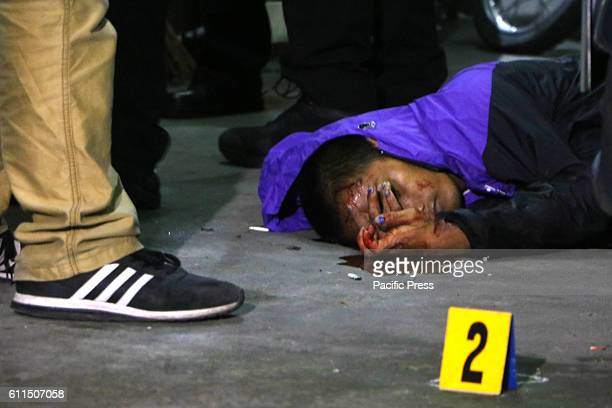 Members of SOCO process the crime scene and the remains of an unidentified suspect after being gunned down by members of Philippine National Police...