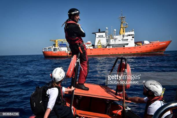 Members of 'SOS Mediterranee' and MSF 'Medecins Sans Frontieres' NGOs perform a sea rescue drill near the MV Aquarius a search and rescue ship which...